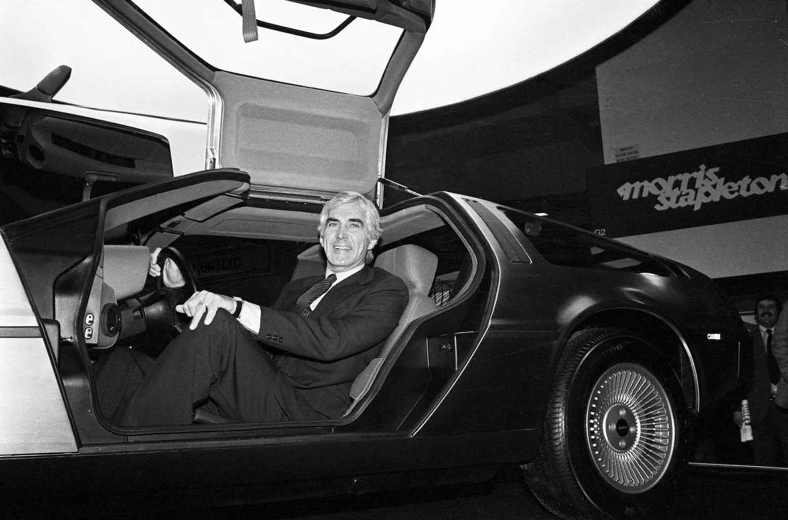 DeLorean sits in his car at the Earl's Court Motor Fair, London. 1981.