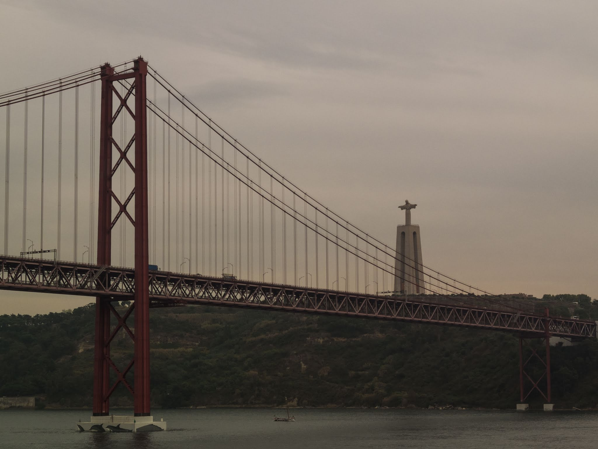 View with the 25 de Abril bridge and Christ the King Sanctuary in Portugal.