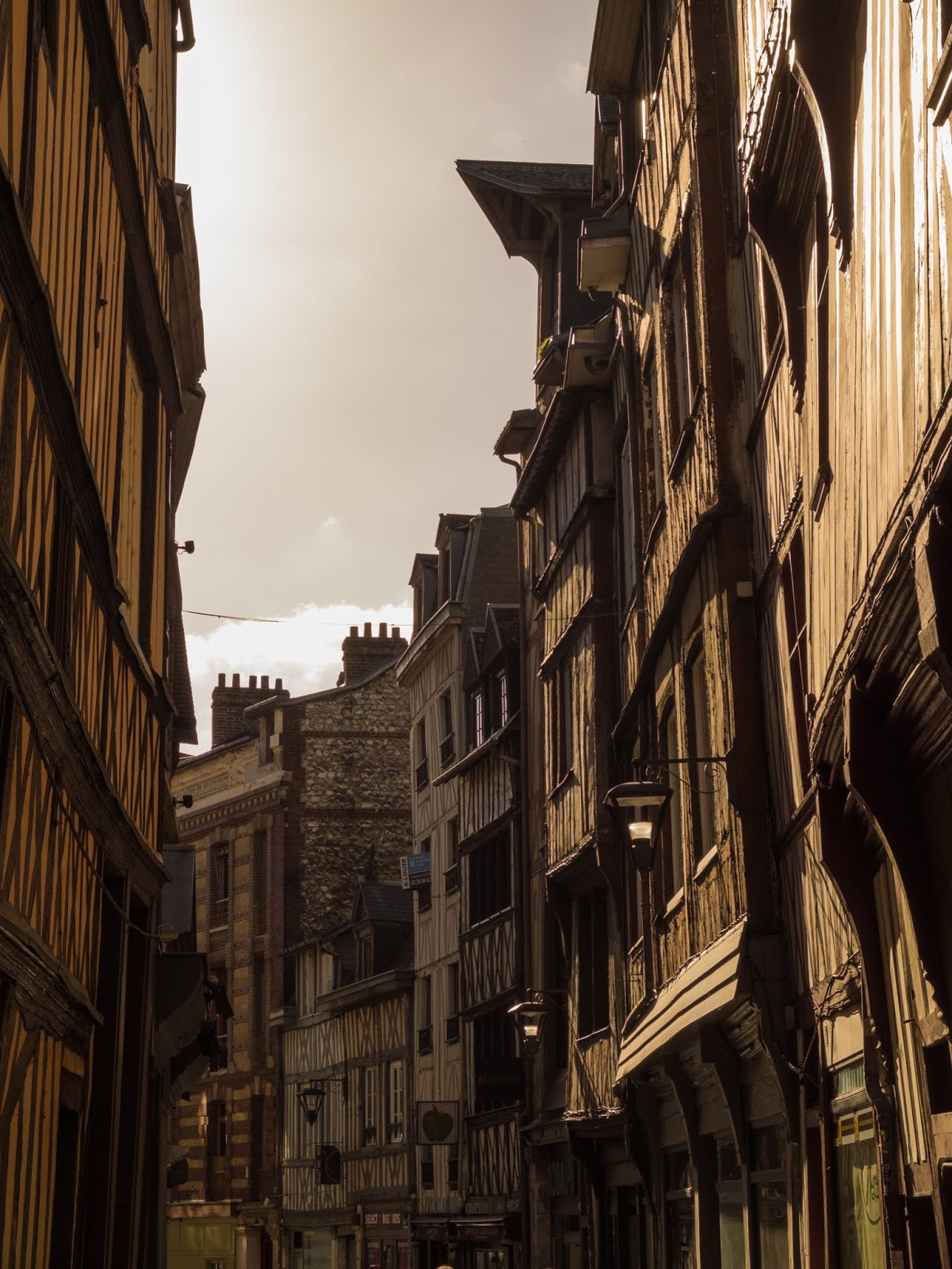 Sunlight on buildings on the Vicomte Street in Rouen, France.