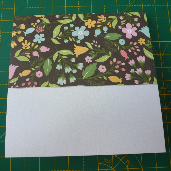 Covering the top of a card blank with patterned black floral scrapbook paper