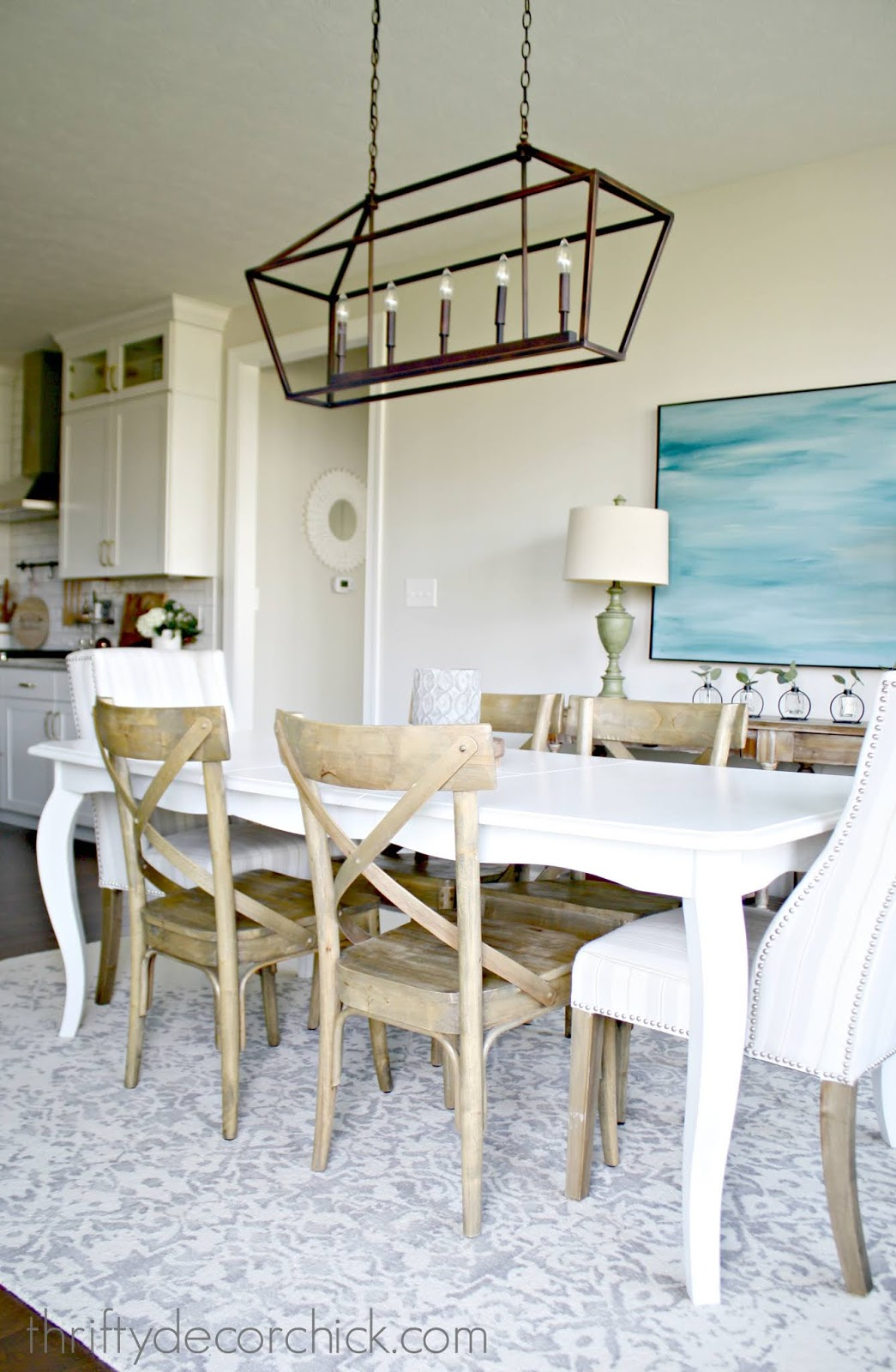 Long chandelier over farmhouse table