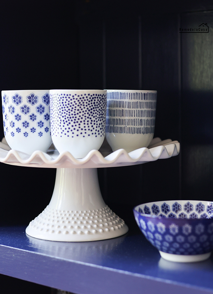 white and blue tea cups and bowl on cake platter