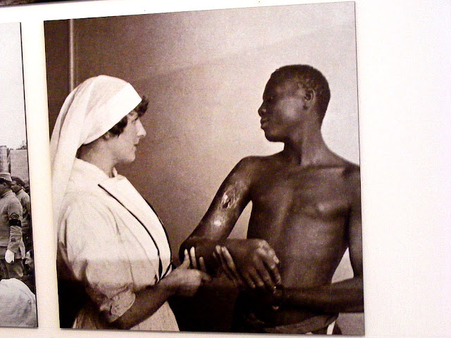 Archive photo of Simone Menier treating a wounded Senegalese rifleman during World War I at the Chateau of Chenonceau. Loire Valley. France.