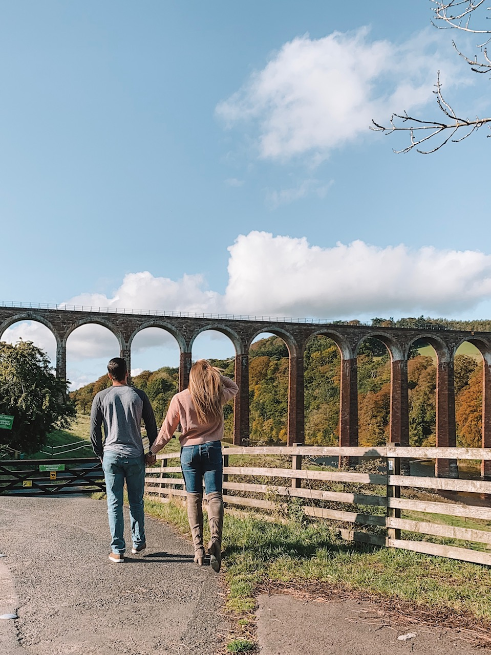 travel blogger Amanda Martin stops at Leaderfoot Viaduct Bridge while road tripping through Scotland