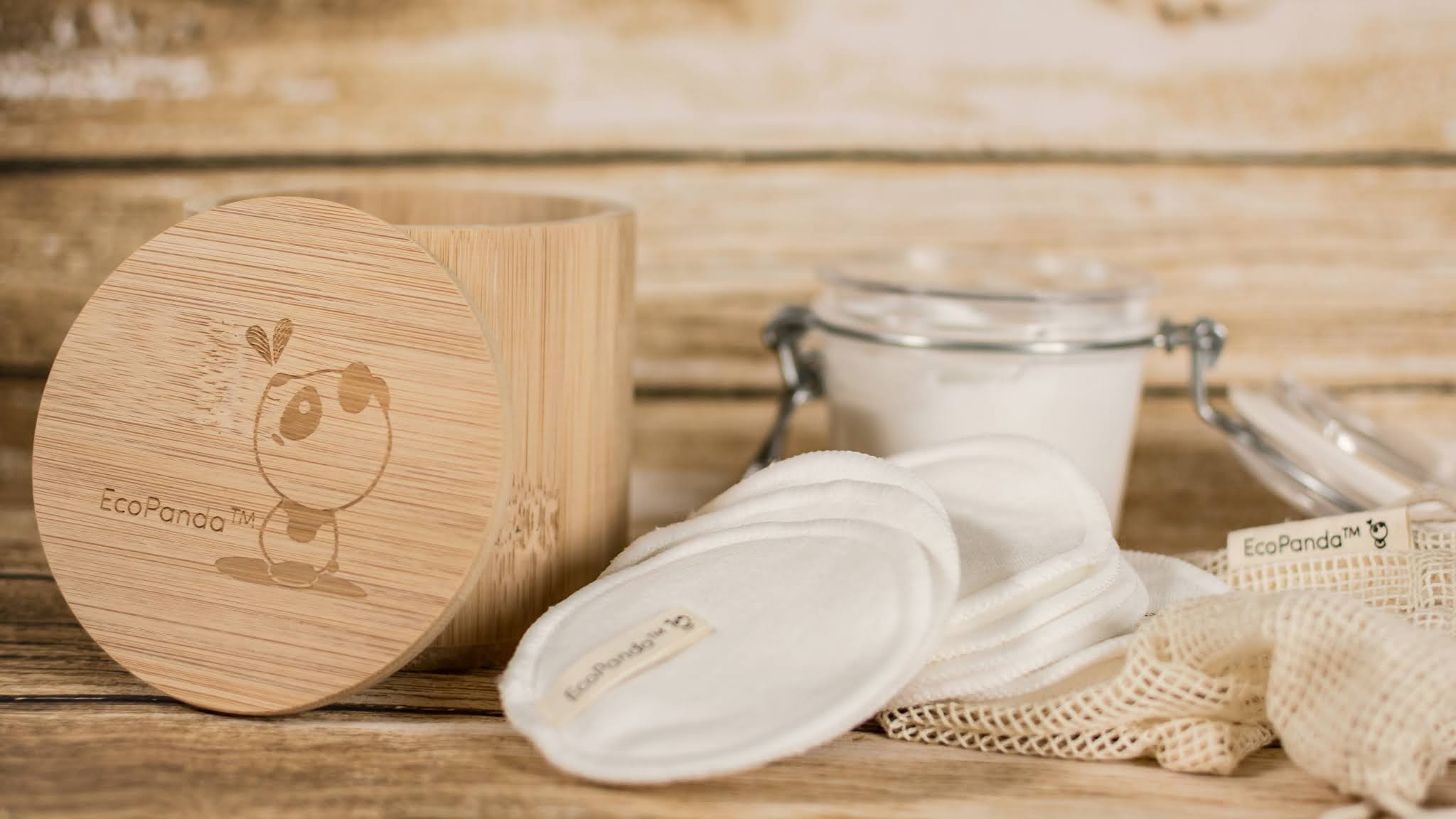 bamboo cotton pads and clear glass jar