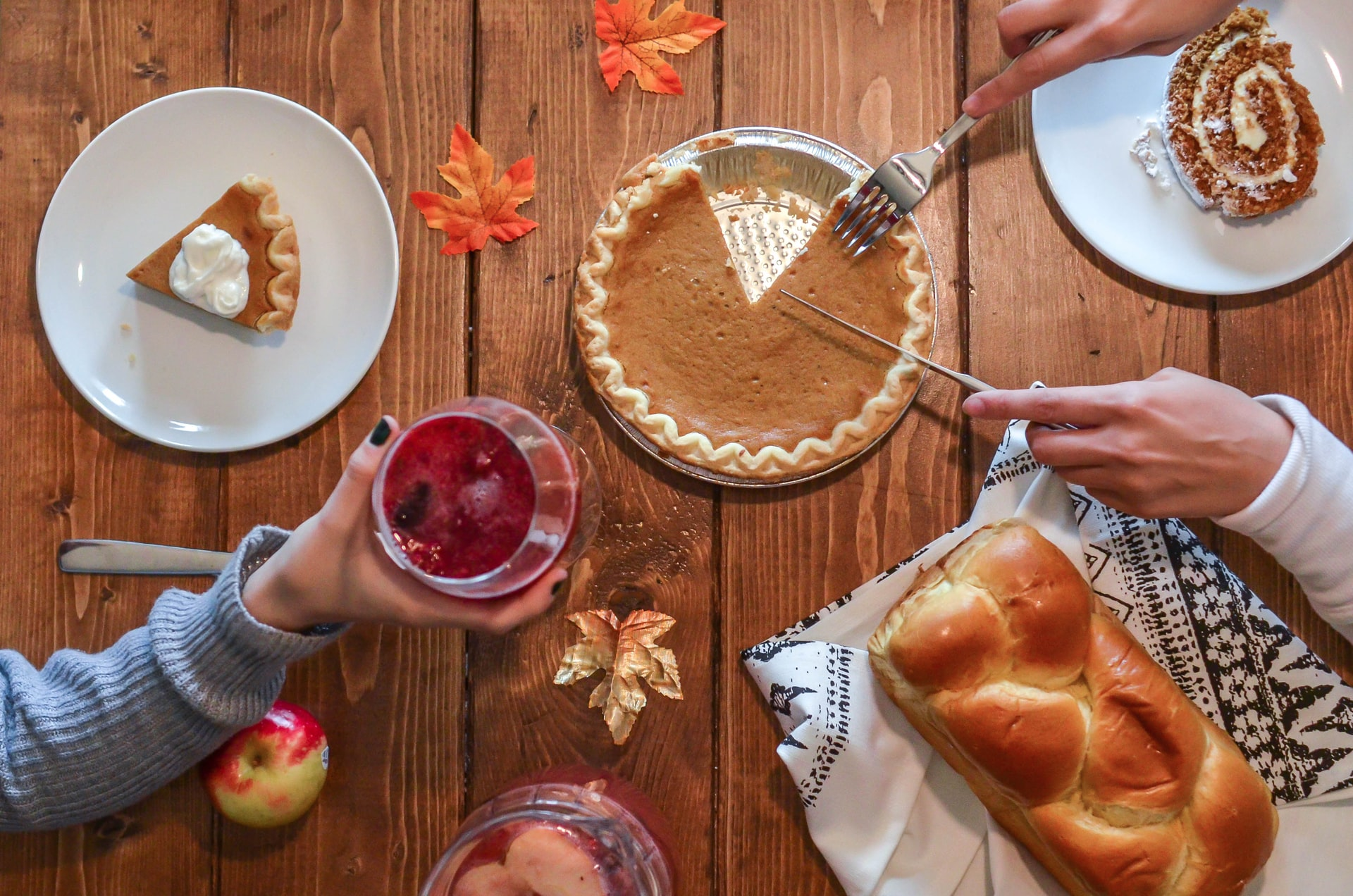 Slicing pumpkin pie beside bread at end of Thanksgiving dinner - Source: Element5 Digital via Unsplash - https://unsplash.com/photos/RPjyNMHDrFY