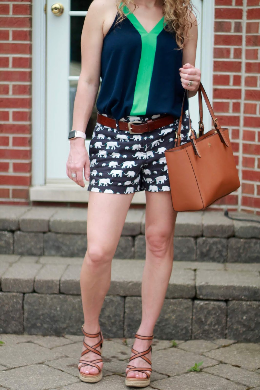 green blue color block cami, white denim jacket, navy elephant print shorts, wedge sandals, tory burch tote