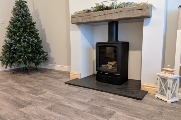 vinyl floorboards open plan living area with log burner and xmas tree