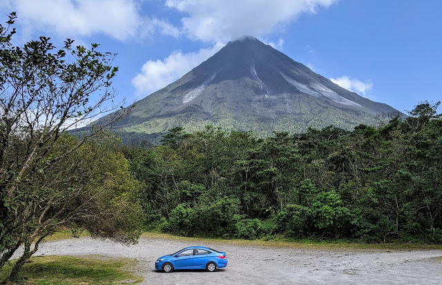 Costa Rica Itinerary: Arenal Volcano with a blue car