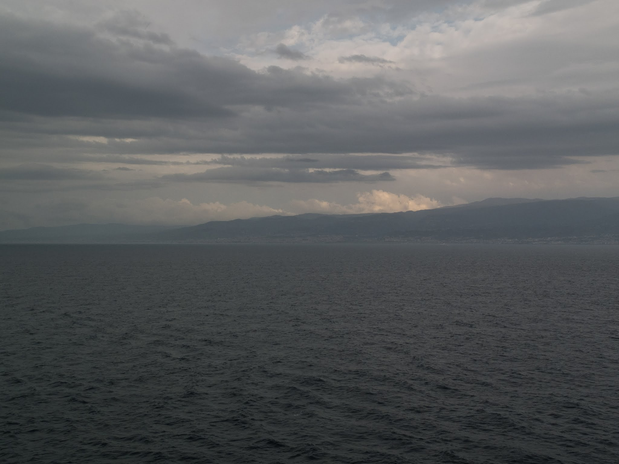 Mediterranean landscape and sky from the sea.