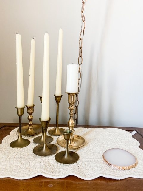 vintage brass candlesticks as night stand decor