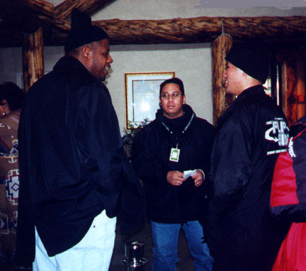 Academy Award winner Forest Whitaker speaks to THE FLIP SIDE director Rod Pulido (in the black beanie cap) at the Sundance Film Festival...in January of 2001.