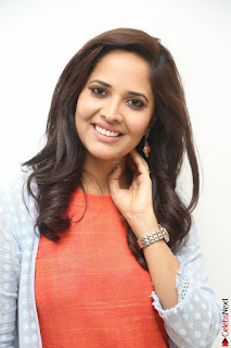 Actress Anasuya Bharadwaj in Orange Short Dress Glam Pics at Winner Movie Press Meet February 2017 (100).JPG