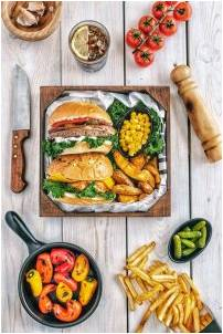 Some healthy burgers and vegetables representing how you can eat healthy during a move without having to sacrifice what you like