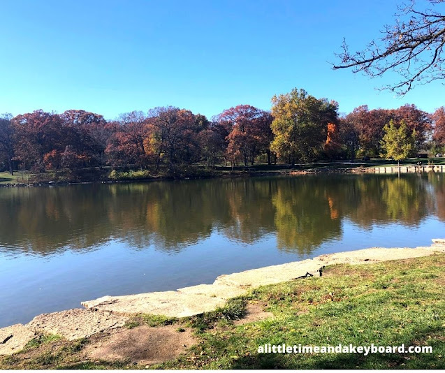 Rusty fall colors frame Herrick Lake in Wheaton, Illinois.