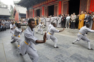 Monks from Africa attend a Buddhist ceremony held at Shaolin Temple in Zhengzhou