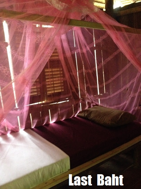 mosquito netting over a bed in a rustic bungalow on Koh Rong Island, Cambodia