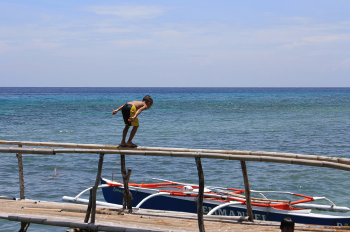 A kid preparing for his dive