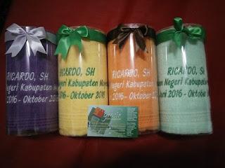 souvenir handuk kenang-kenangan pensiun atau pindah tugas kemasan mika tabung + pita ikat atas