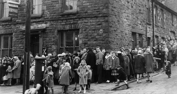 In 1962 Rhondda Valley Residents queuing for their smallpox vaccinations, after the Welsh area was declared to be an infected area. Photograph: Getty Images.