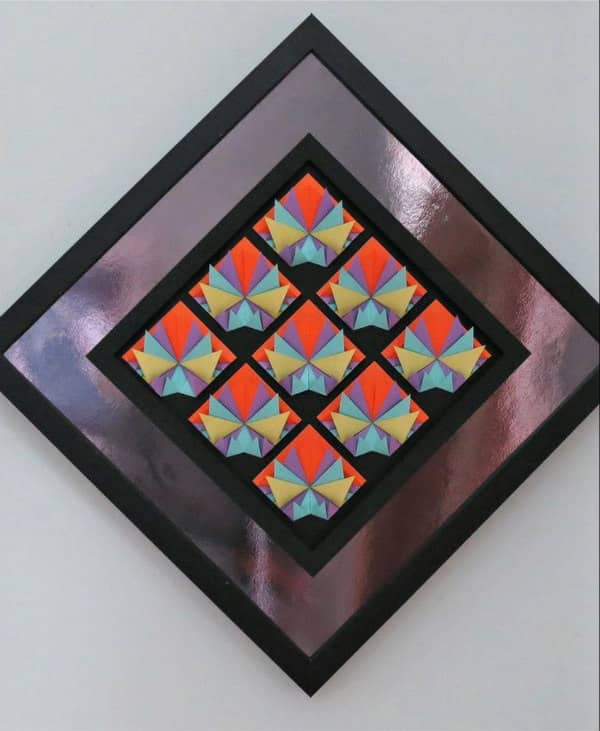 square 3d folded paper sculpture mounted on mirror paper