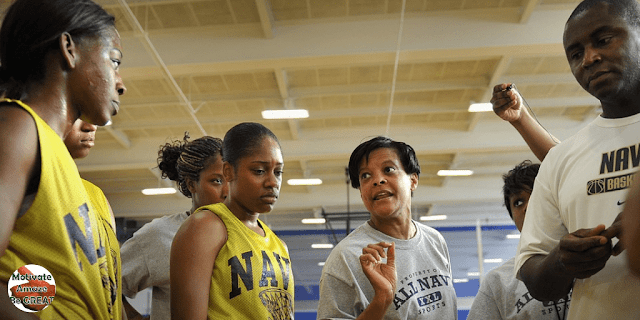 """Featured in the article: """"How To Motivate Youth Basketball Players"""". Don't Let Your Emotions Take Over, coach talking to youth basketball player in a proper controlled manner."""