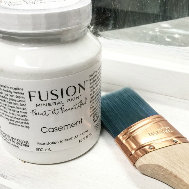 fusion mineral paint in casement with a brush