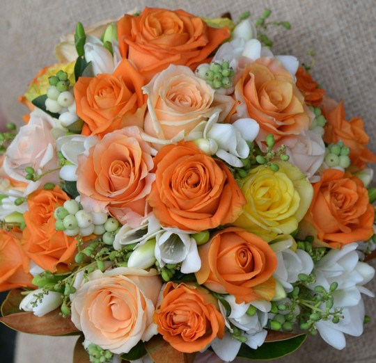 orange rose wedding bouquet of carpe diem roses
