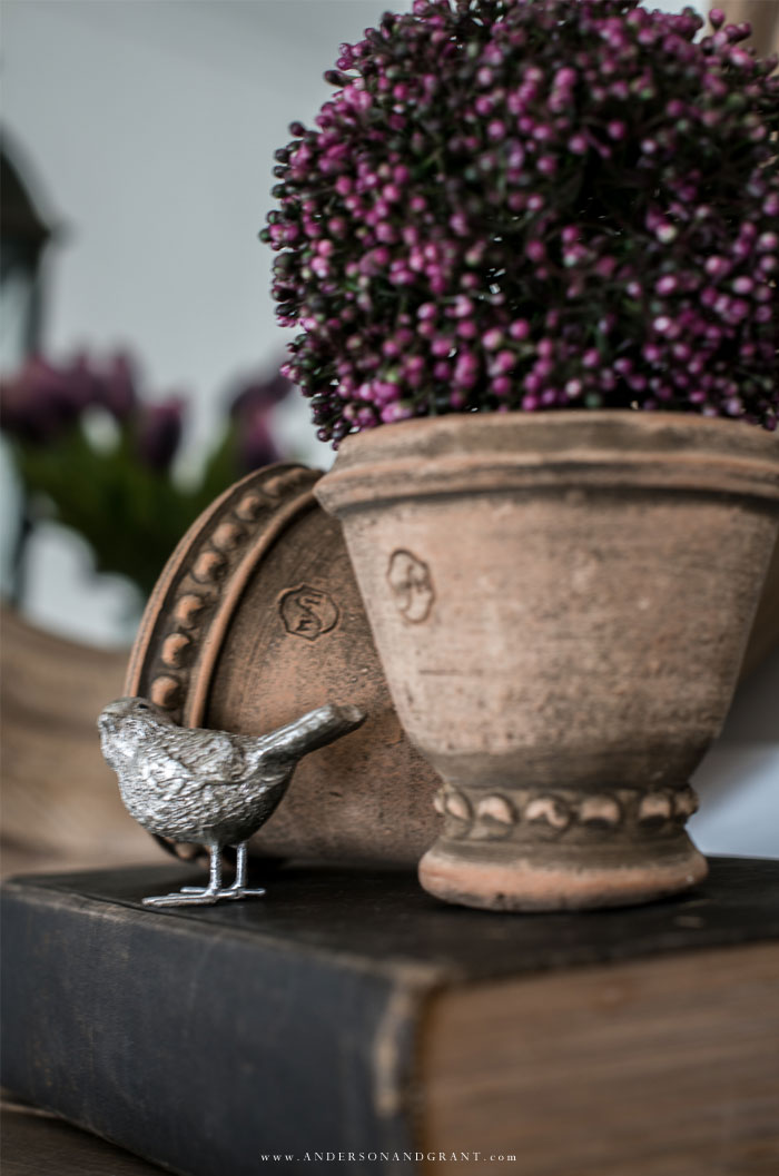 Silver bird and mini clay pots