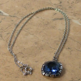 Blue glass pendant necklace by Exquisite