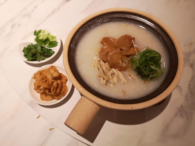 Abalone and shredded kampung chicken with conpoy congee served in claypot