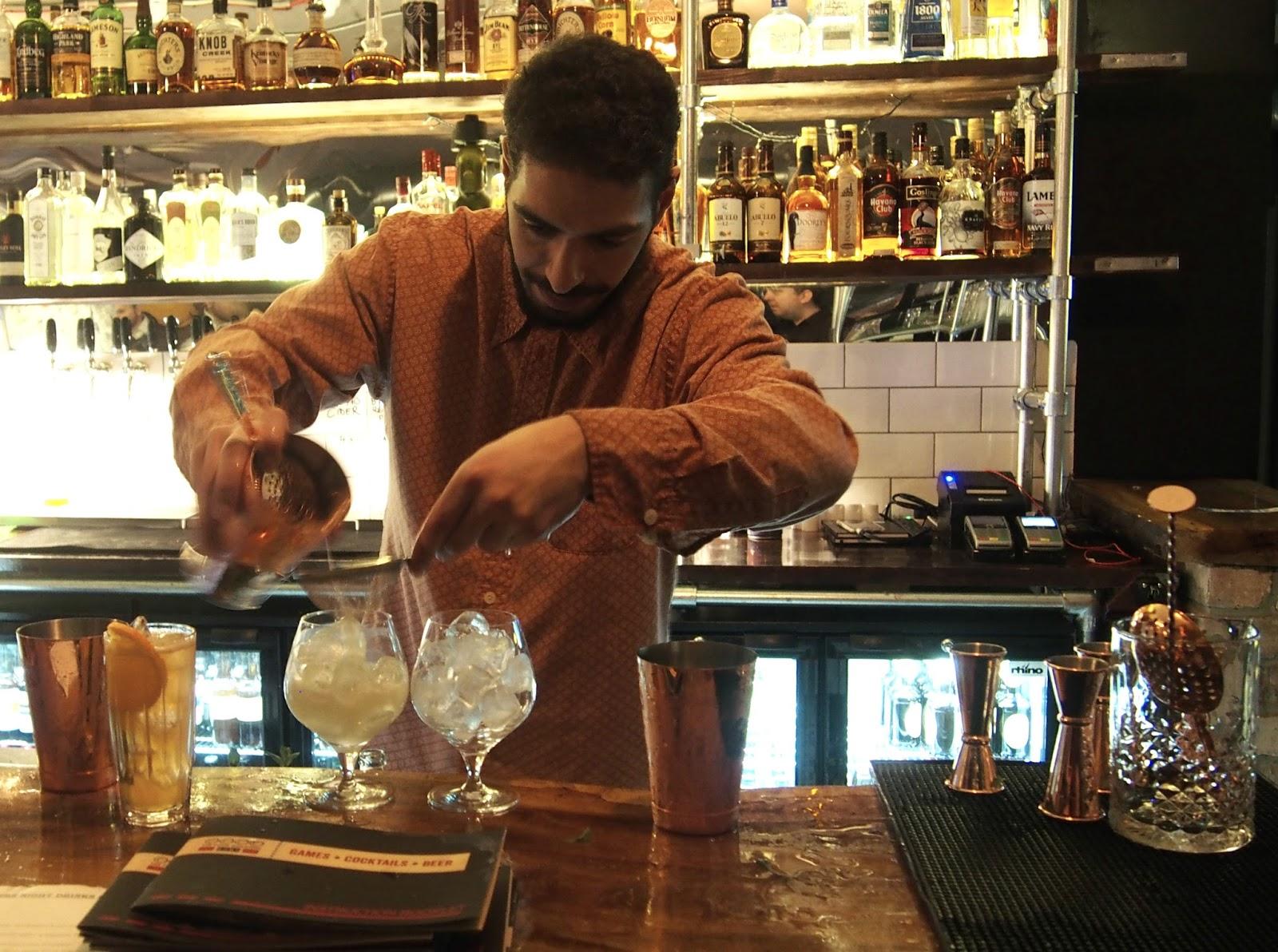 Waiter serving cocktail