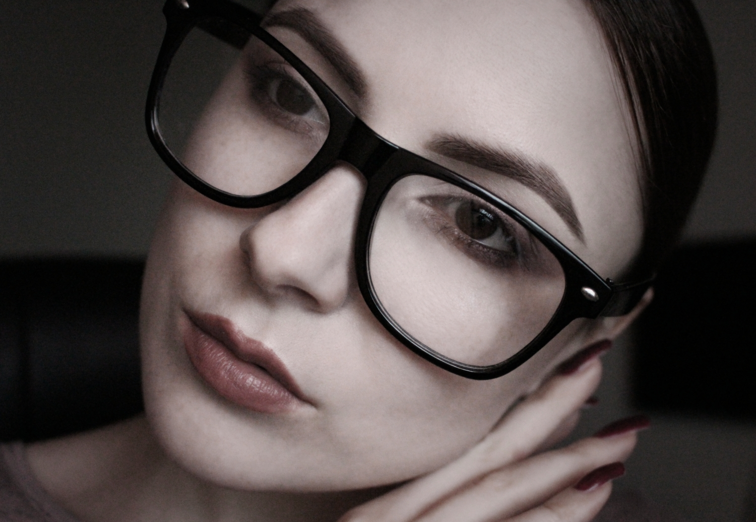nerd girl in huge black glasses