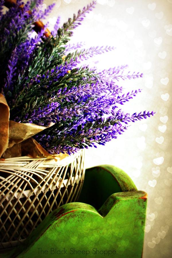 Lavender bundles in basket on a Antibes Green cabinet.