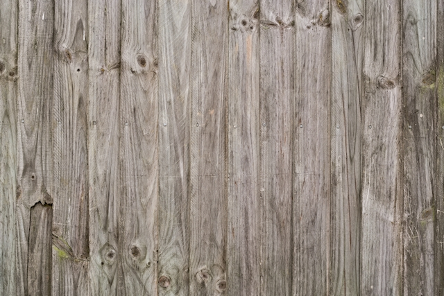Broken vertical wood fence texture