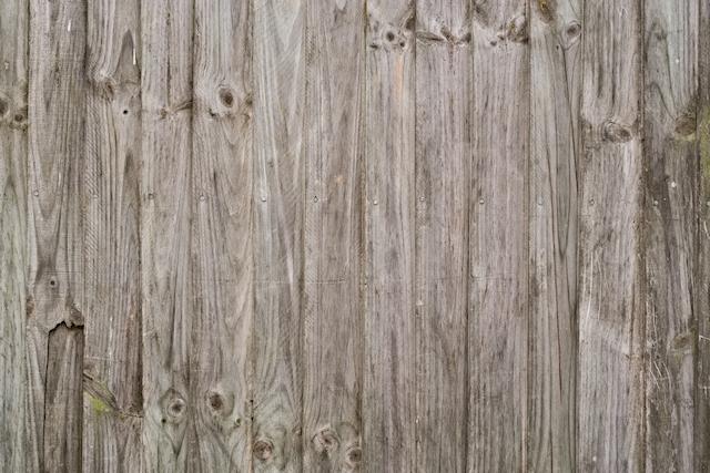 Broken vertical wood fence texture