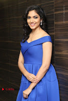 Actress Ritu Varma Pos in Blue Short Dress at Keshava Telugu Movie Audio Launch .COM 0066.jpg