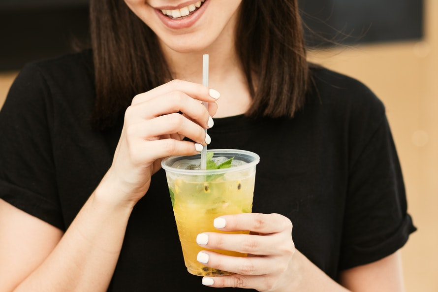 street-bars-woman-drinking-cocktail-in-plastic