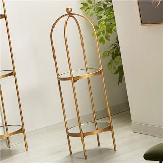estanteria redonda para baño dorada