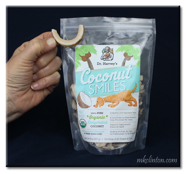 Bag of Dr. Harvey's Coconut Smiles with had holding one