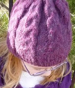 http://www.ravelry.com/patterns/library/kinleys-braided-cable-hat