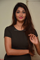 Priya Vadlamani super cute in tight brown dress at Stone Media Films production No 1 movie announcement 015.jpg