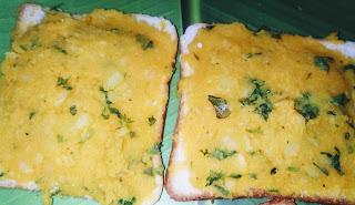 Spreading potato mixture over the bread slices for bread pakora recipe
