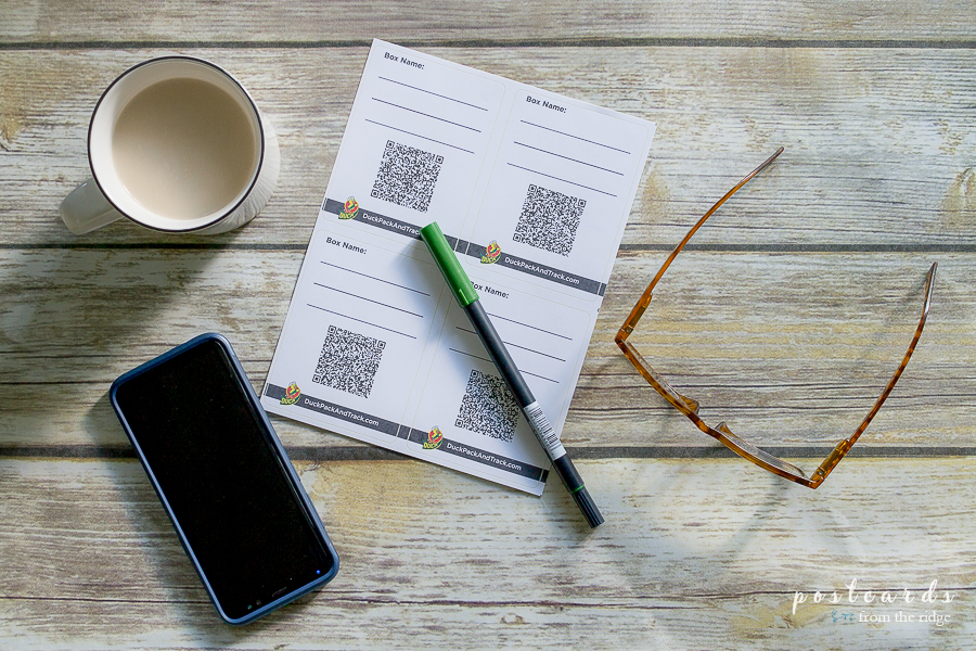 Duck Pack and Track labels with pen, phone, coffee cup and glasses