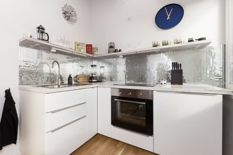 Small kitchen with shiny tablets.