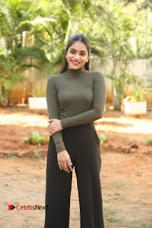 Tollywood Actress Punarnavi Bhupalam Latest Po Gallery in Black Trouser Pant at Pittagoda Movie Interview  0063.JPG