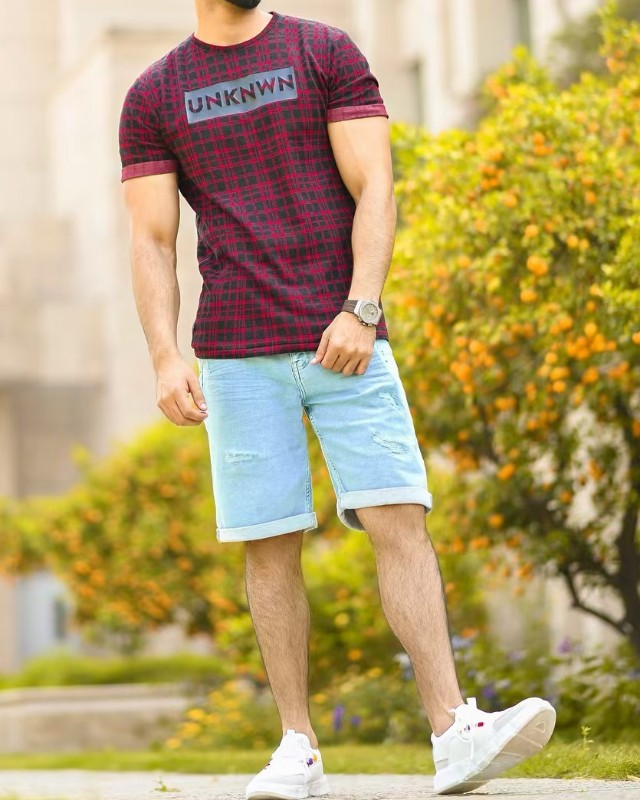 Burgundy tee and blue shorts
