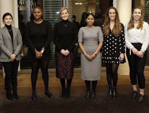 The Countess is Chair of the DoFE (The Duke of Edinburgh's Award) Women's Network Forum. flared print knit midi skirt black red