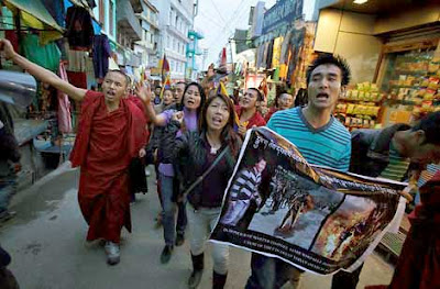 Tibetans stage protest, Tibetans protest in Dharamsala, monk death in China, monk burnt, Self immolation, monk immolation