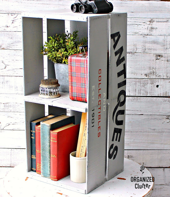 Crate shelf stenciled with Antiques & Collectibles